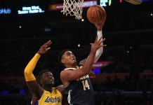 Oct 2, 2017; Los Angeles, CA, USA; Denver Nuggets guard Gary Harris (14) shoots the ball past Los Angeles Lakers forward Julius Randle (30) during the first quarter at Staples Center. Mandatory Credit: Richard Mackson-USA TODAY Sports