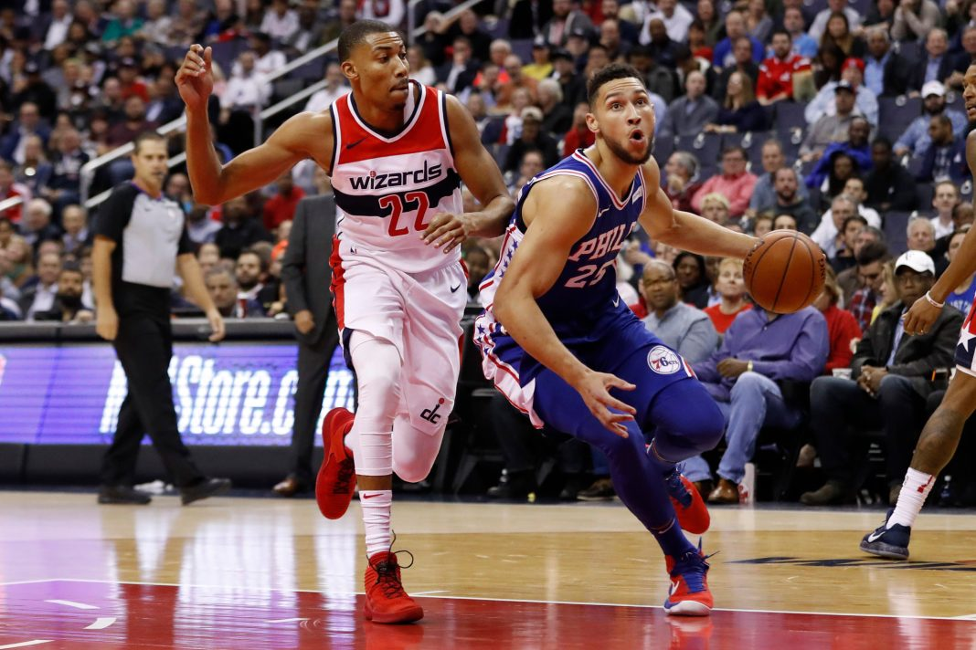 Oct 18, 2017; Washington, DC, USA; Philadelphia 76ers guard Ben Simmons (25) drives to the basket as Washington Wizards forward Otto Porter Jr. (22) defends in the first quarter at Capital One Arena. Mandatory Credit: Geoff Burke-USA TODAY Sports