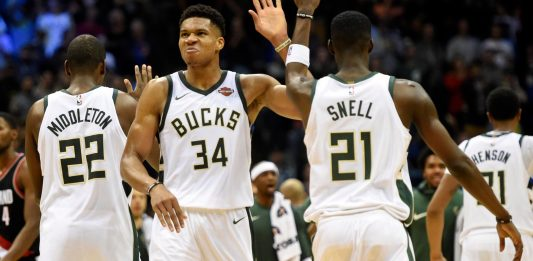Oct 21, 2017; Milwaukee, WI, USA; Milwaukee Bucks forward Giannis Antetokounmpo (34) celebrates with forward Khris Middleton (22) and guard Tony Snell (21) after scoring the go-ahead basket late in the fourth quarter against the Portland Trail Blazers at BMO Harris Bradley Center. Mandatory Credit: Benny Sieu-USA TODAY Sports