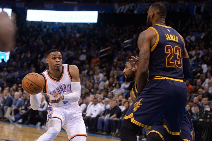 Feb 9, 2017; Oklahoma City, OK, USA; Oklahoma City Thunder guard Russell Westbrook (0) drives to the basket in front of Cleveland Cavaliers guard <a rel=