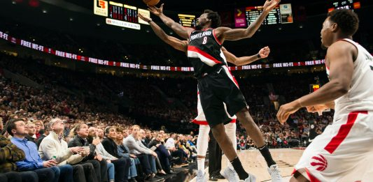 Oct 30, 2017; Portland, OR, USA; Portland Trail Blazers forward Al-Farouq Aminu (8) breaks up a pass intended for Toronto Raptors guard DeMar DeRozan (10) during the first half at Moda Center. Mandatory Credit: Troy Wayrynen-USA TODAY Sports