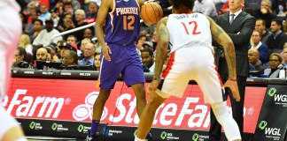 Nov 1, 2017; Washington, DC, USA; Phoenix Suns forward TJ Warren (12) dribbles as Washington Wizards forward Kelly Oubre Jr. (12) defends during the second half at Capital One Arena. Mandatory Credit: Brad Mills-USA TODAY Sports