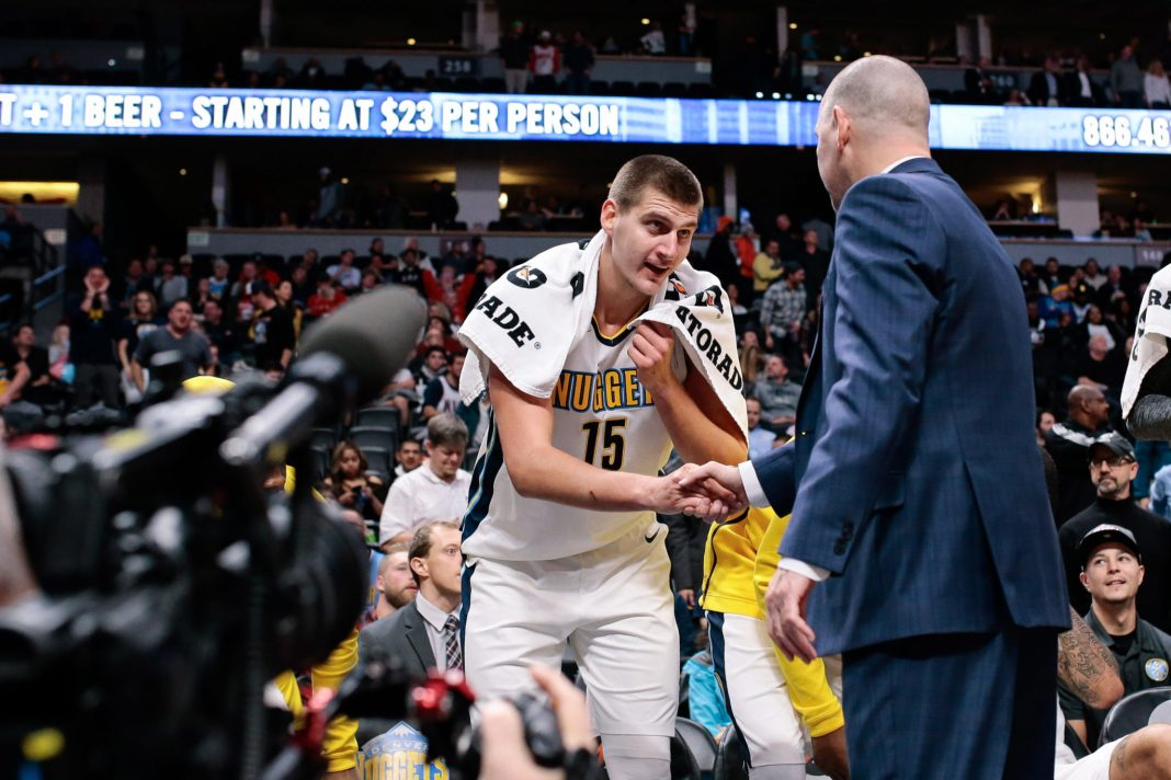Nov 7, 2017; Denver, CO, USA; Denver Nuggets head coach Michael Malone shakes hands with center Nikola Jokic (15) after he fouled out of the game in the fourth quarter against the Brooklyn Nets at the Pepsi Center. Mandatory Credit: Isaiah J. Downing-USA TODAY Sports