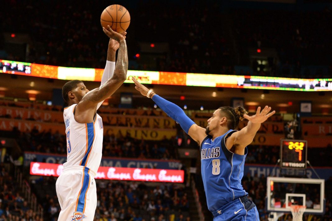 Nov 12, 2017; Oklahoma City, OK, USA; Oklahoma City Thunder forward Paul George (13) shoots the ball over Dallas Mavericks guard Gian Clavell (8) during the fourth quarter at Chesapeake Energy Arena. Mandatory Credit: Mark D. Smith-USA TODAY Sports