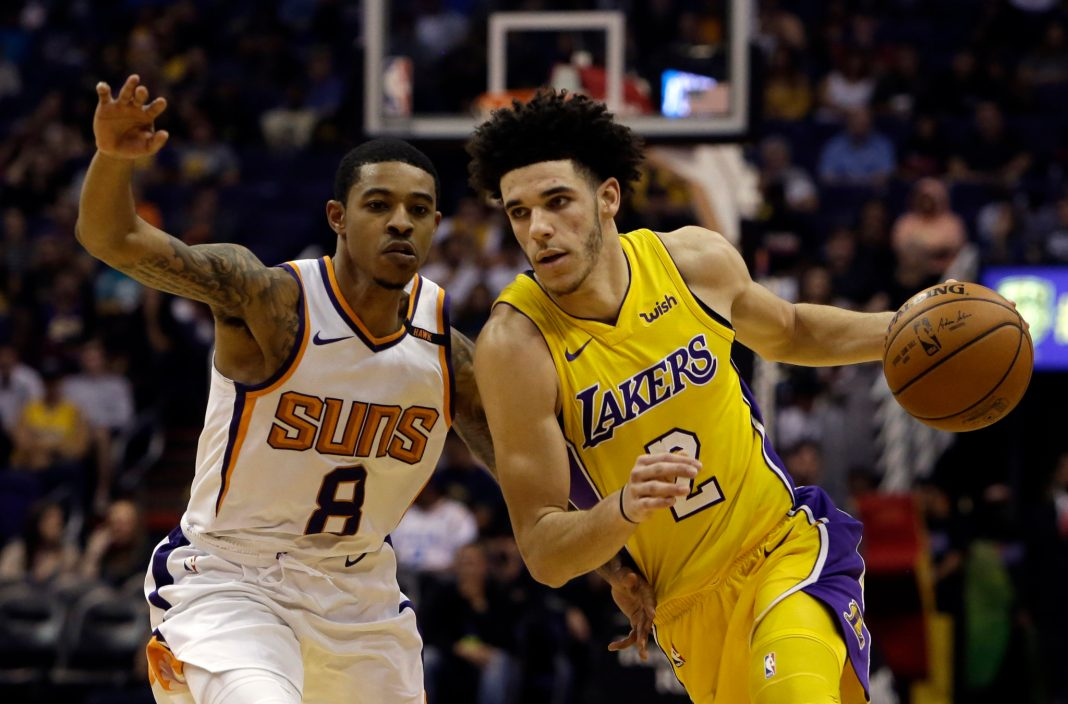 Nov 13, 2017; Phoenix, AZ, USA; Los Angeles Lakers guard Lonzo Ball (2) drives on Phoenix Suns guard Tyler Ulis (8) in the second half at Talking Stick Resort Arena. Mandatory Credit: Rick Scuteri-USA TODAY Sports