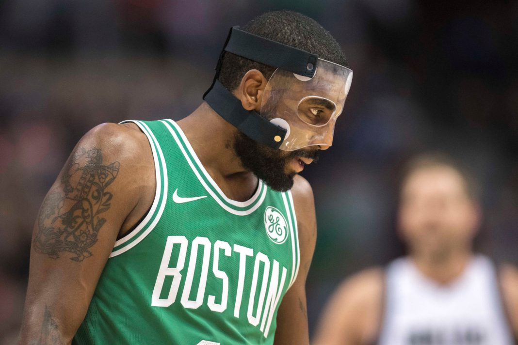 Nov 20, 2017; Dallas, TX, USA; Boston Celtics guard Kyrie Irving (11) waits for play to resume against the Dallas Mavericks during the second half at the American Airlines Center. The Celtics defeat the Mavericks 110-102. Mandatory Credit: Jerome Miron-USA TODAY Sports