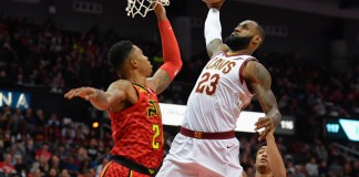 Nov 30, 2017; Atlanta, GA, USA; Cleveland Cavaliers forward LeBron James (23) dunks against Atlanta Hawks guard Kent Bazemore (24) during the first half at Philips Arena. Mandatory Credit: Dale Zanine-USA TODAY Sports