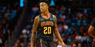 Oct 20, 2017; Charlotte, NC, USA; Atlanta Hawks forward John Collins (20) stands on the court in the first half against the Charlotte Hornets at Spectrum Center. Mandatory Credit: Jeremy Brevard-USA TODAY Sports