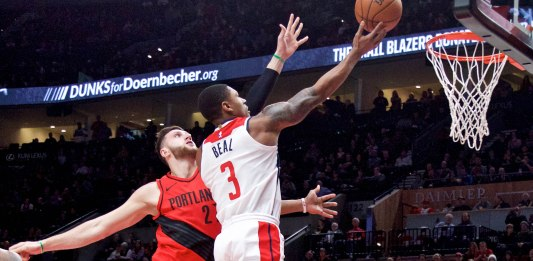 Dec 5, 2017; Portland, OR, USA; Washington Wizards guard Bradley Beal (3) shoots over Portland Trail Blazers center Jusuf Nurkic (27) during the first quarter at the Moda Center. Mandatory Credit: Craig Mitchelldyer-USA TODAY Sports