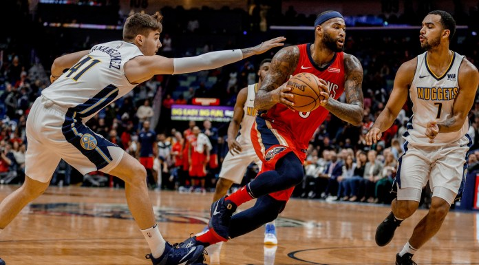 Dec 6, 2017; New Orleans, LA, USA; New Orleans Pelicans center DeMarcus Cousins (0) drives past Denver Nuggets forward Trey Lyles (7) and forward Juan Hernangomez (41) during the second half at the Smoothie King Center. The Pelicans defeated the Nuggets 123-114. Mandatory Credit: Derick E. Hingle-USA TODAY Sports
