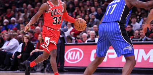 Dec 20, 2017; Chicago, IL, USA; Chicago Bulls guard Kris Dunn (32) dribbles the ball against Orlando Magic forward Jonathon Simmons (17) during the first half at the United Center. Mandatory Credit: Mike DiNovo-USA TODAY Sports