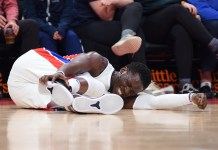 Dec 26, 2017; Detroit, MI, USA; Detroit Pistons guard Reggie Jackson (1) reacts after being injured during the third quarter against the Indiana Pacers at Little Caesars Arena. Mandatory Credit: Tim Fuller-USA TODAY Sports