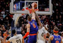 Dec 30, 2017; New Orleans, LA, USA; New York Knicks forward Kristaps Porzingis (6) dunks the ball during the forth period against New Orleans Pelicans center DeMarcus Cousins (0) at Smoothie King Center. Mandatory Credit: Stephen Lew-USA TODAY Sports