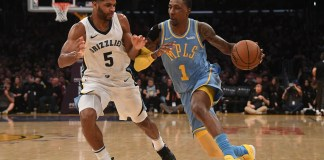 Dec 27, 2017; Los Angeles, CA, USA; Los Angeles Lakers guard Kentavious Caldwell-Pope (1) dribbles the ball as Memphis Grizzlies guard Andrew Harrison (5) defends during the second half at Staples Center. Mandatory Credit: Richard Mackson-USA TODAY Sports
