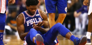 Dec 31, 2017; Phoenix, AZ, USA; Philadelphia 76ers center Joel Embiid (21) reacts on the ground after injuring his hand against the Phoenix Suns in the second half at Talking Stick Resort Arena. Mandatory Credit: Mark J. Rebilas-USA TODAY Sports