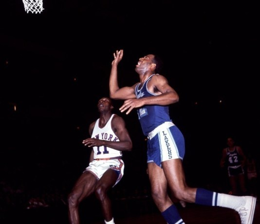 1960's: Elgin Baylor of the Los Angeles Lakers with a shot during a Lakers game versus the New York Knickerbockers at Madison Square Garden in Manhattan, New York. Mandatory Credit: Icon Sports Media