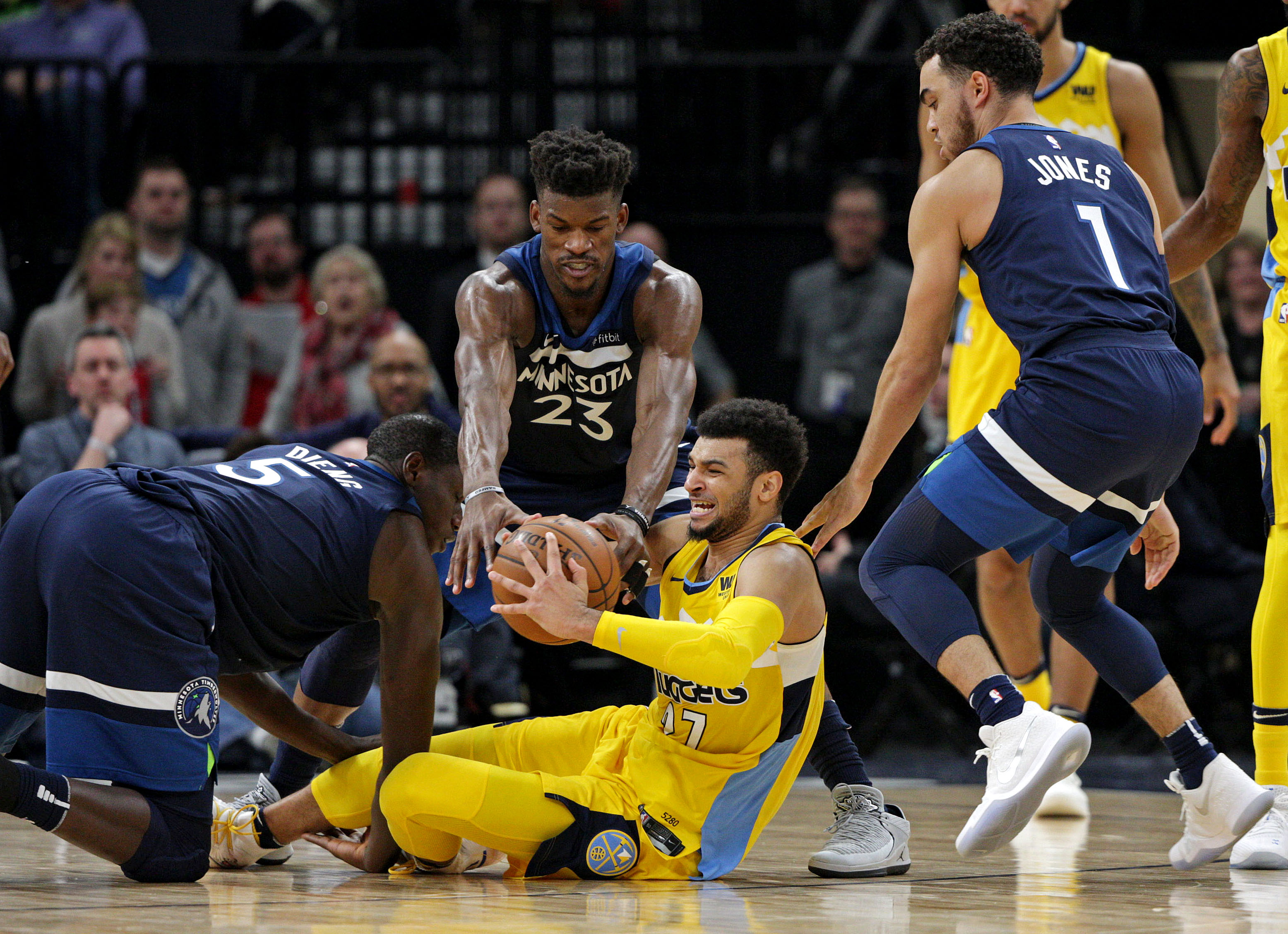 Timberwolves howl, beat Nuggets in OT to reach playoffs