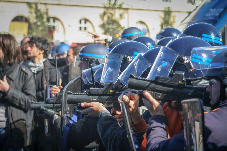 They prefer Flash Ball guns. Facing protestors, Paris.