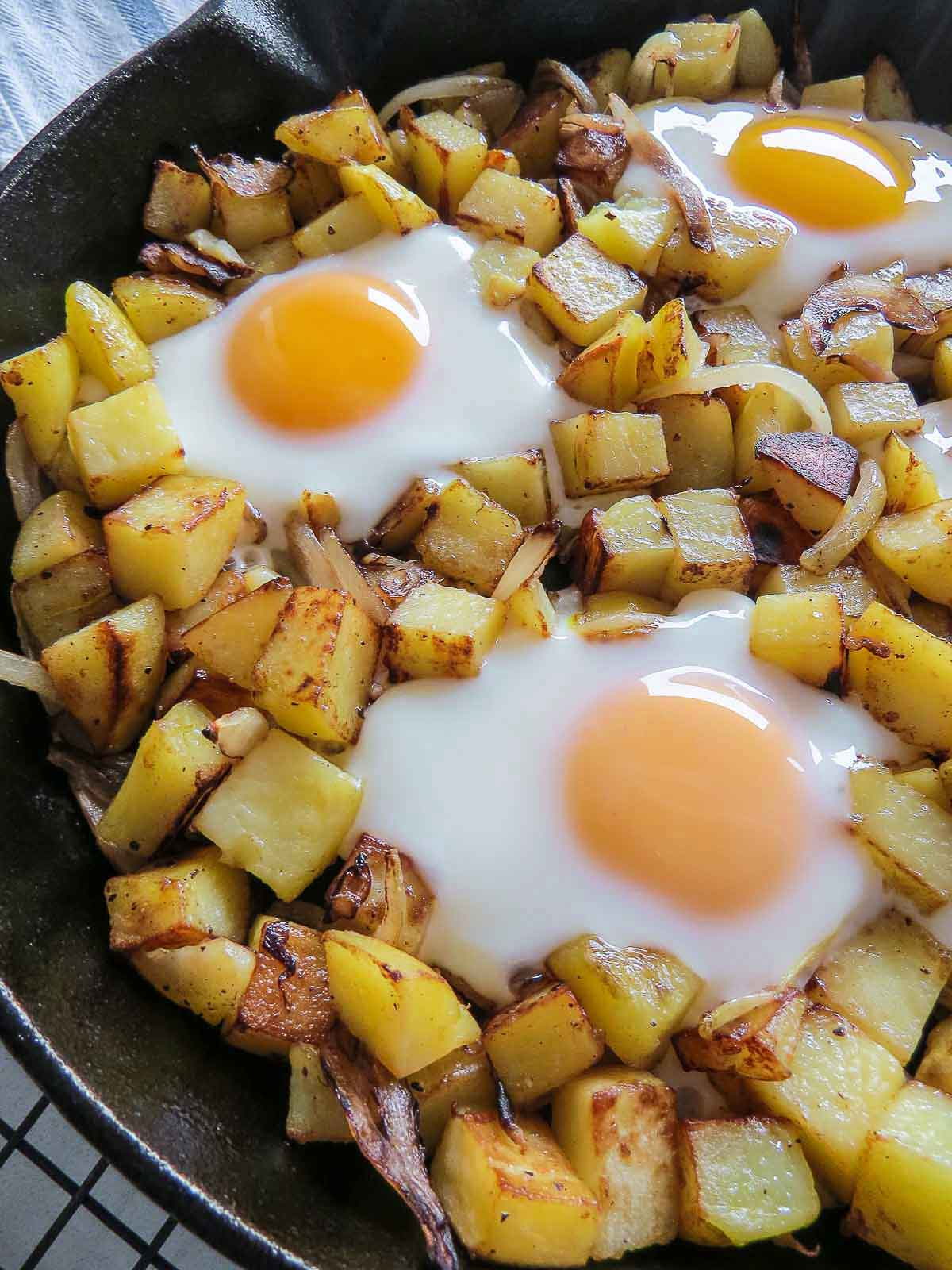 Hash & Eggs - This one pan wonder is sure to be the star of any breakfast or brunch! Loaded with potatoes, onions and eggs it is perfect to start any day!