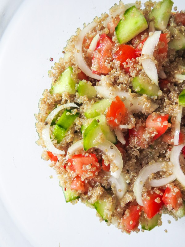 Simple Lemony Quinoa Salad - Fresh tomatoes, cucumbers and onions, tossed with quinoa and lemon juice makes this salad recipe perfect for a hot day in the sun!