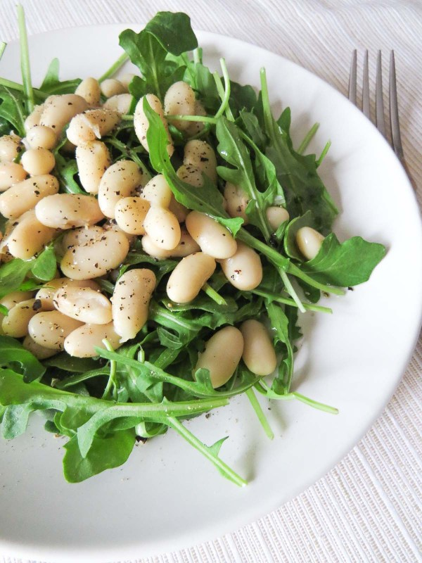 White Bean Arugula Salad - Sophisticated and classy are adjectives that come to mind when I think of this yummy arugula salad topped with seasoned cannellini beans. What more could you want from a simple starter or lunch?!