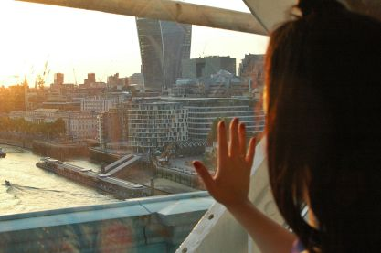 Erica pressing her hand against the window and looking longingly at the fresh air