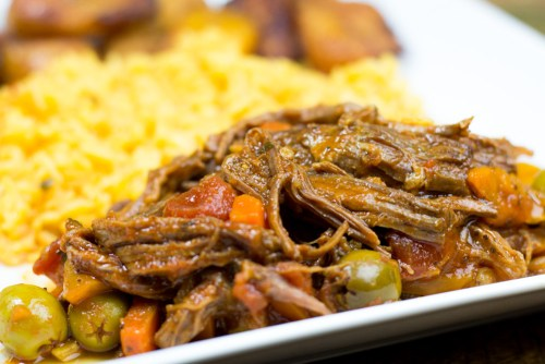 Ropa vieja - shredded beef with veggies in a beautiful sauce. Cuban comfort food in your slow cooker or pressure cooker!