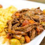Ropa Vieja - Cuban dish of flank cooked with veggies in a beautiful sauce! Shred and serve with yellow rice or plantains. Pressure cooker and slow cooker instructions!