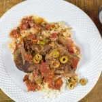 Pressure cooker Spanish beef is tender, briny deliciousness! Easy for a weeknight meal or impressive enough for company!