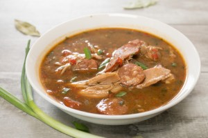 Delicious chicken and sausage gumbo anyone can make. It all stars with a flawless oven roux and ends with chicken and sausage gumbo goodness!