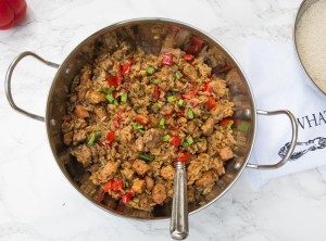 Pork jambalaya with burnt sugar - browned sugar, tender pork pieces cooked with rice and veggies. Cajun goodness!