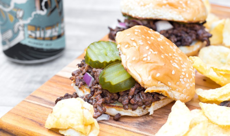 Ground meat simmered in tasty, dark beer with onion, pepper, and spices served up hot on a buttered bun! Mom would be proud.