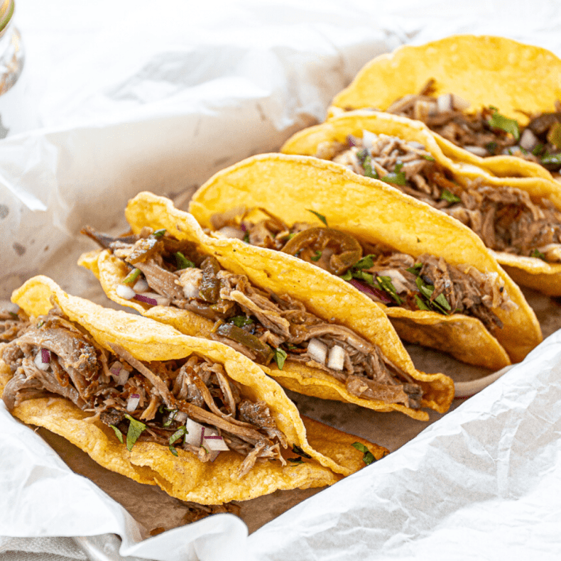 These crazy delicious pork tacos, made in your slow cooker, will keep you coming back for more!  Simple ingredients yield impressive flavors!