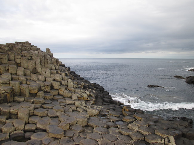 The basalt rock formations along the water