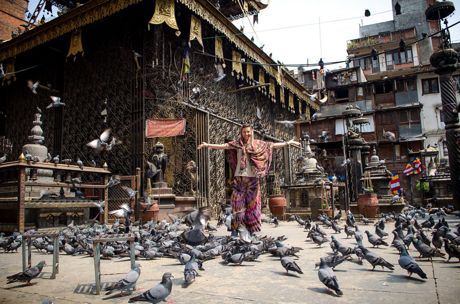 Standing in the middle of pigeons at a temple in Kathmandu, Nepal.