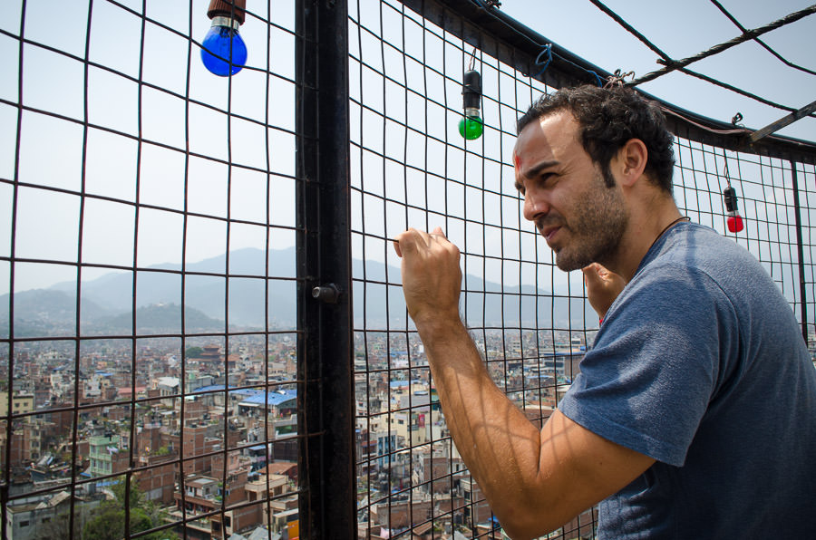 Adrian looking at Kathmandu, Nepal from atop the white tower.