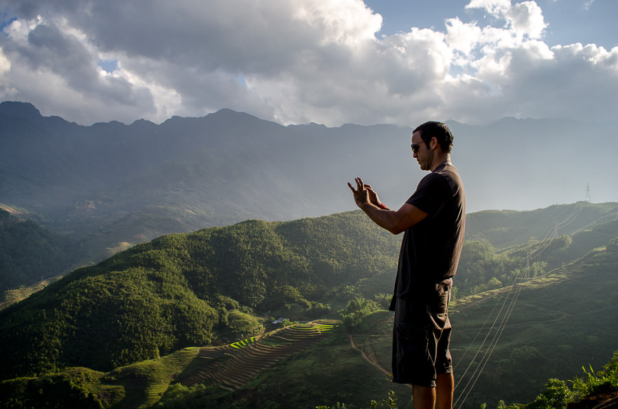 Adrian taking a photo of the valley with his iphone.