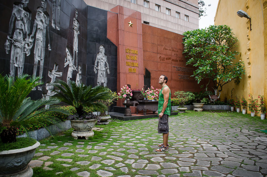 Adrian standing in front of the memorial wall at the War Prison in Hanoi, Vietnam.