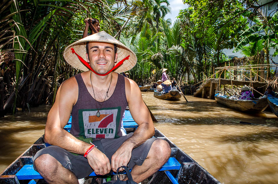 Adrian riding in a small boat down one the Mekong Delta tributaries.