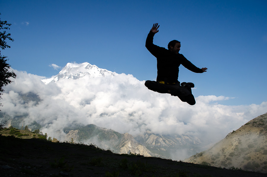 Adrian jumping in front of the mountain in Nwagal