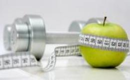 apple, measuring tape and chrome dumbbell