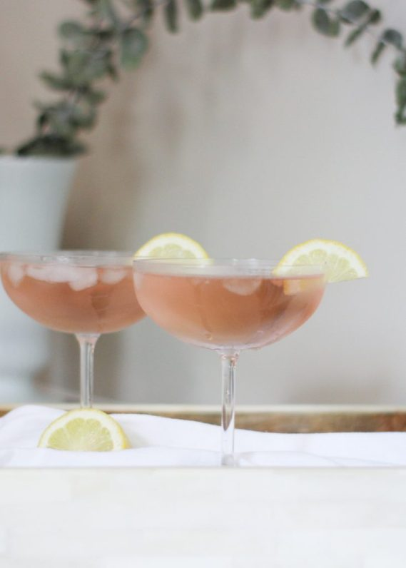 PINK FRENCH 75 COCKTAIL | This is a pink and girly take on the classic French 75 cocktail recipe, made with gin or vodka, elderflower liquor, fresh lemon juice and sparkling pink rosé. This is perfect for your next girl's night in. Cheers! #happyhour #cocktailtime #cocktailhour #girlsnight