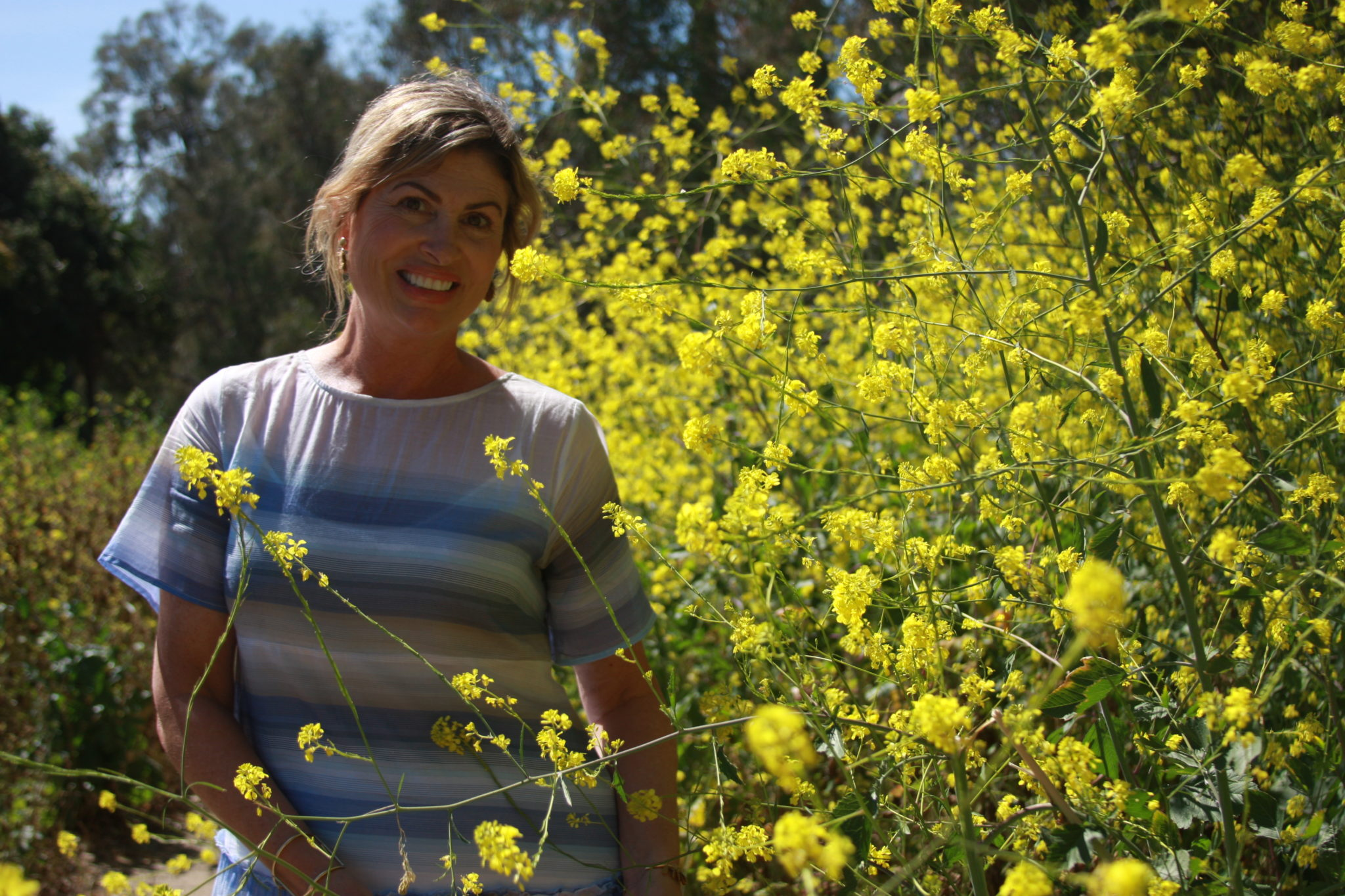 Lishawn Lalonde, Founder and Formulator of Uliv Skincare surrounded by nature