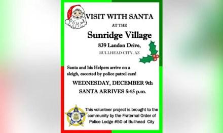 Santa arrives escorted by police patrol cars