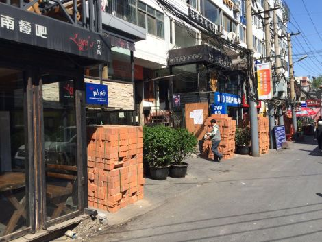 R Dirty Bar Street to Be Cleaned Up By Beijing's Ongoing Brick Laying