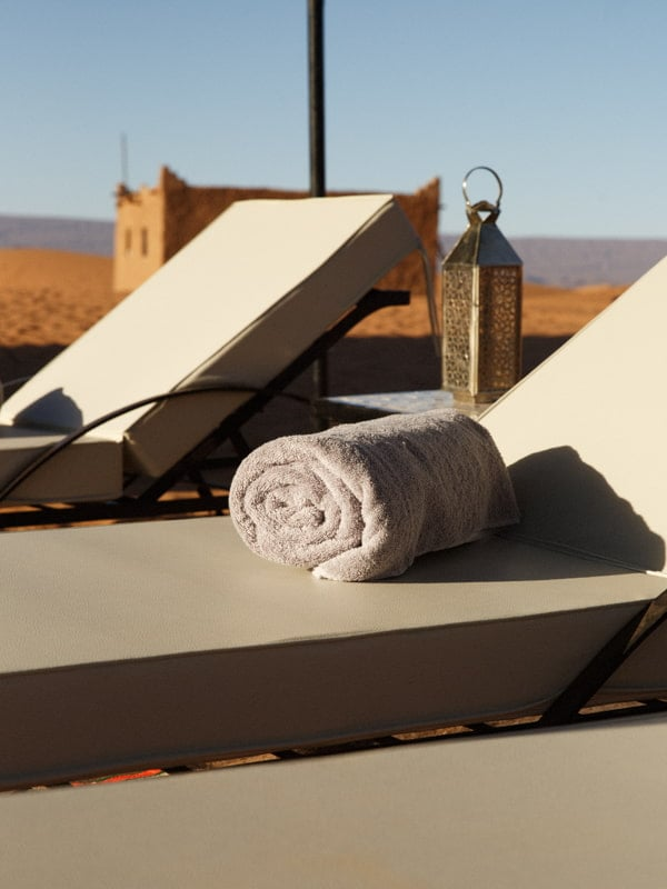 Luxury Sun Loungers and Complimentary Towels at Desert Camp