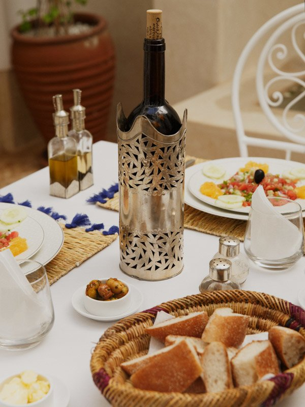 Moroccan Meal, Bottle of Wine, Condiments, Salad dish, Bread Rolls with Sesame Seeds