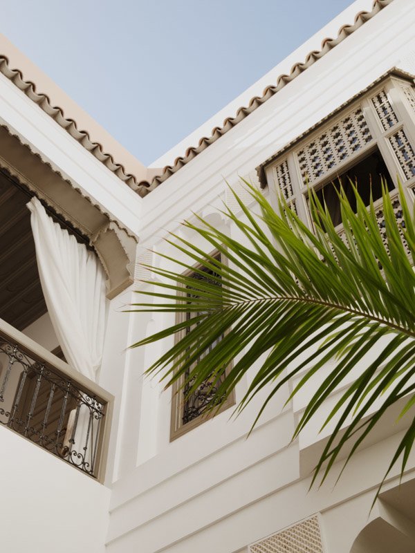 Exterior View of Hotel Balcony from Courtyard With Palm Branch