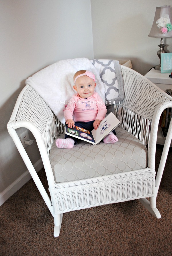 Enjoying Books in a cute girly nursery at thebensonstreet.com