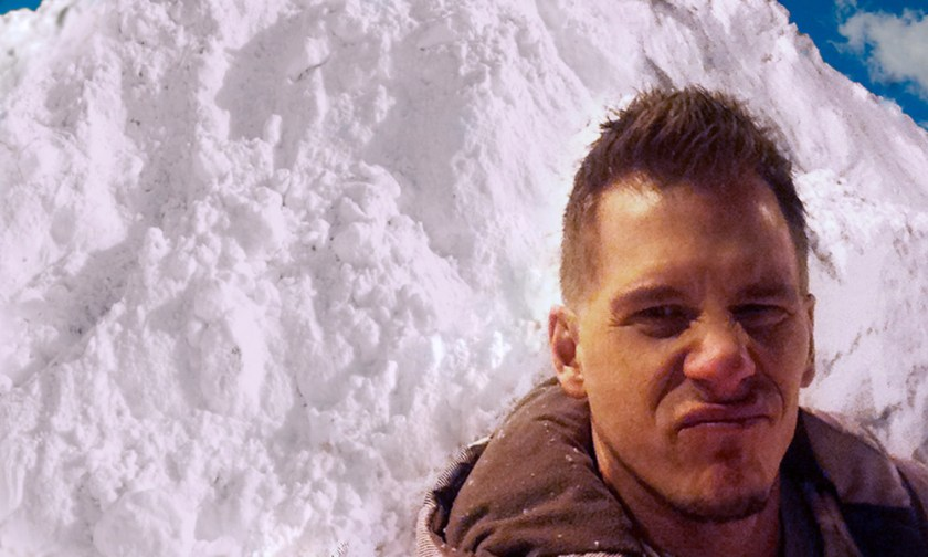 The Best Advice So Far - digging out - Erik with *yuck* face standing in front of a mountain of plowed snow